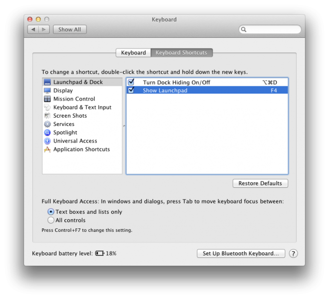 "The macOS System Preferences Keyboard Shortcuts pane. ""Show Launchpad"" is mapped to F4."