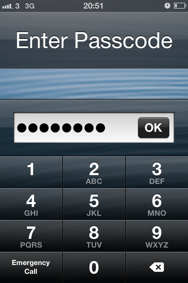 iPhone lock screen with a long passcode entered into a text field.