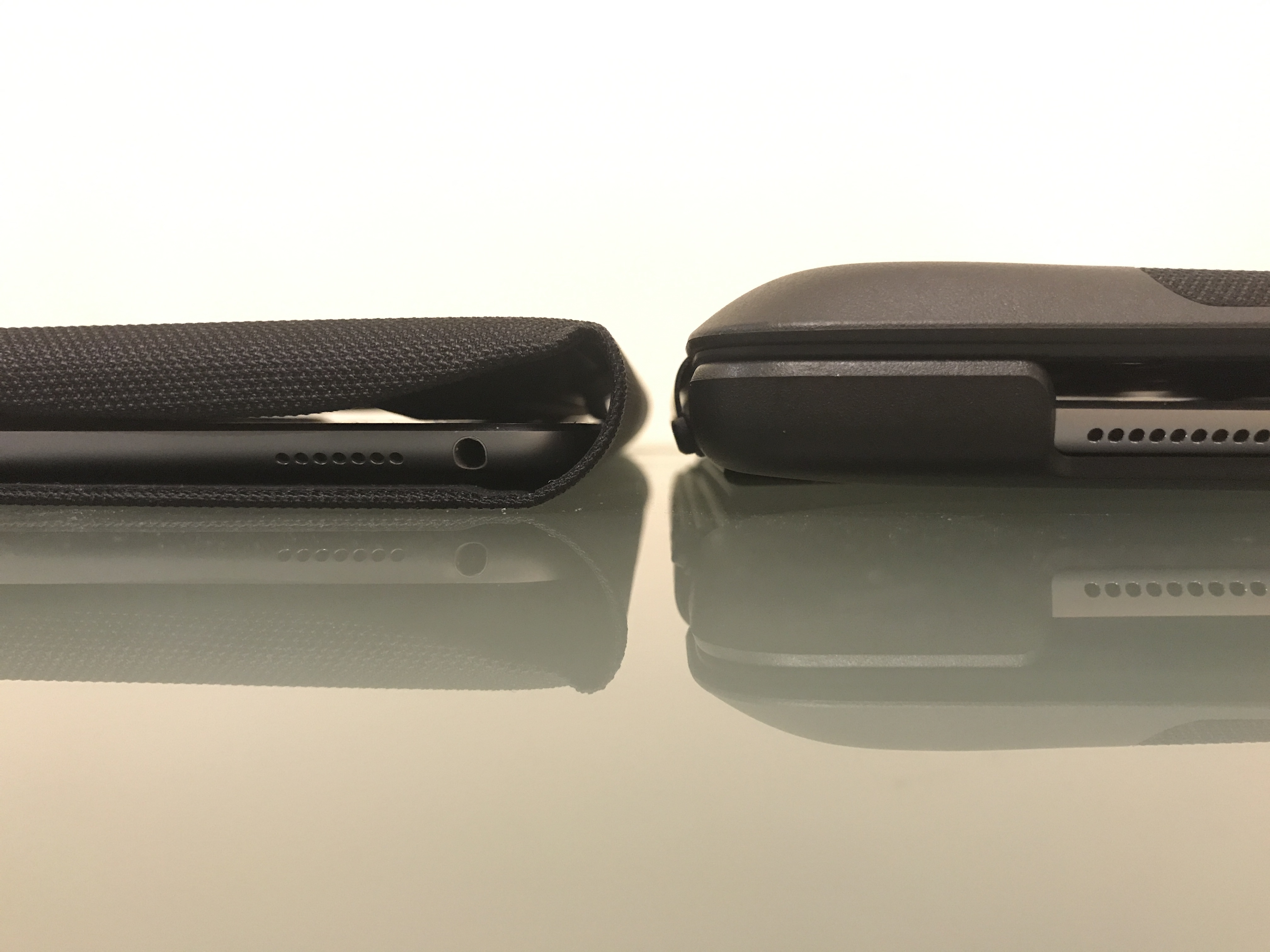 The side view of the Logitech case and the Apple Smart Keyboard next to each other. The Logitech case is about a third thicker than the Apple one.